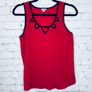 Kismet red sleeveless top with cut outs at collar